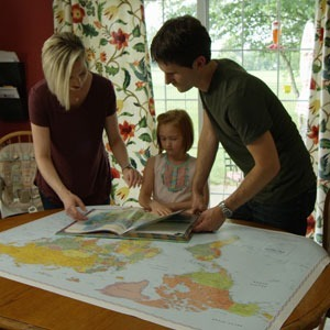 Family looking at world map